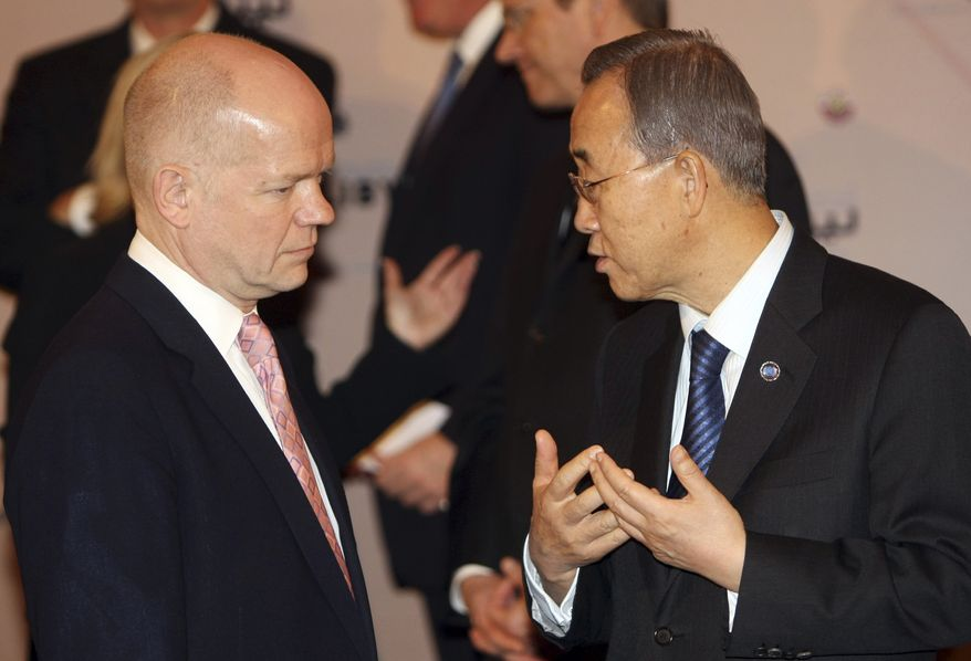 U.N. Secretary-General Ban Ki-moon (right) speaks with British Foreign Secretary William Hague in the Qatari capital, Doha, at meeting of the Libya Contact Group on Wednesday, April 13, 2011. Libyan rebels are in Qatar to call for stronger international pressure on Col. Moammar Gadhafi's regime as Western and Arab envoys gather to discuss options. (AP Photo/Osama Faisal)