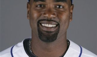 FILE - This is a 2009 file photo of Carlos Delgado  of the New York Mets baseball team. Delgado has given up on coming back from a hip injury, announcing his retirement from baseball two years after he was sidelined. The former New York Mets and Toronto Blue Jays first baseman announced his decision at a news conference in his native Puerto Rico on Wednesday, April 13, 2011.  (AP Photo/Jeff Roberson, File)