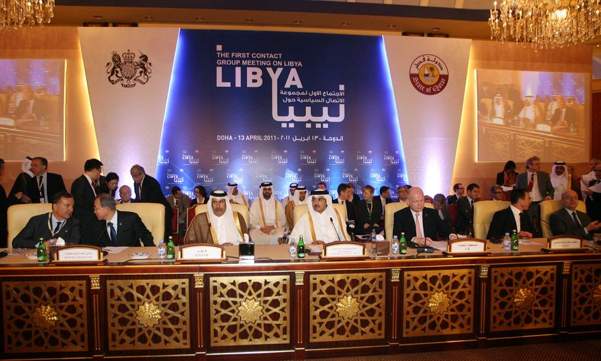 Delegates from the Libya Contact Group meet in Doha, Qatar, on Wednesday, April 13, 2011. Representatives of the Libyan rebels called for stronger international pressure on Col. Moammar Gadhafi's regime as Western and Arab envoys gathered to discuss options. (AP Photo/Osama Faisal)