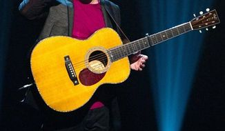 "FILE - In this Oct. 2, 2010 file photo, singer Paul Simon appears on stage at Comedy Central's  ""Night Of Too Many Stars: An Overbooked Concert For Autism Education"" at the Beacon Theatre in New York. (AP Photo/Charles Sykes, file)"