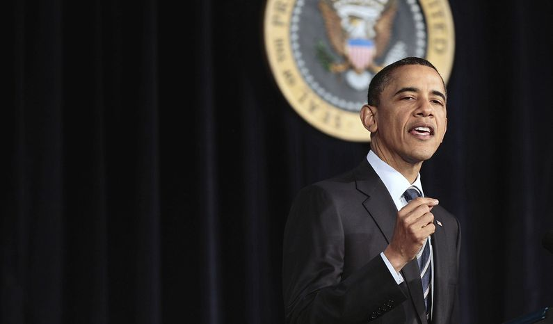 President Obama announces his fiscal policy during an address at George Washington University in Washington on Wednesday, April 13, 2011. (AP Photo/Pablo Martinez Monsivais)