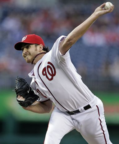 Washington Nationals starting pitcher John Lannan throws during the first inning of a baseball game against Philadelphia Phillies at Nationals Park on Wednesday, April 13, 2011, in Washington. (AP Photo/Manuel Balce Ceneta)