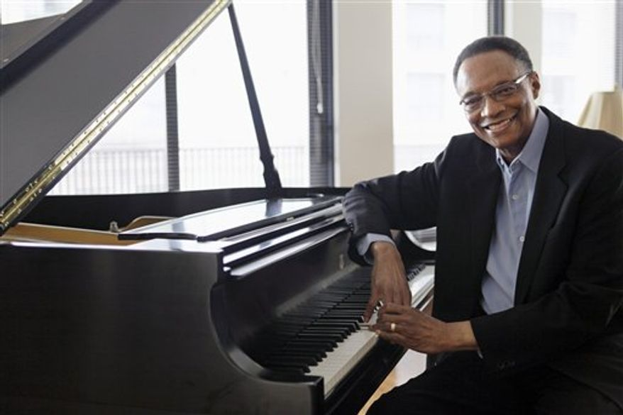 "In this photo taken April 5, 2011, jazz pianist and composer Ramsey Lewis describes his composing methods during an interview at his home in Chicago. His latest work is a tribute to Abraham Lincoln, ""Proclamation of Hope: A Symphonic Poem by Ramsey Lewis."" It airs nationally on PBS stations starting Thursday. (AP Photo/M. Spencer Green)"