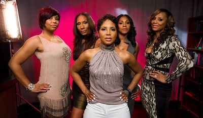 """In this April 4, 2011 photo, the Braxton sisters, Toni, center, and from left, Towanda, Traci, Trina and Tamar of the WeTV reality series, """"Braxton Family Values,"""" pose for a portrait in New York. (AP Photo/Charles Sykes)"""