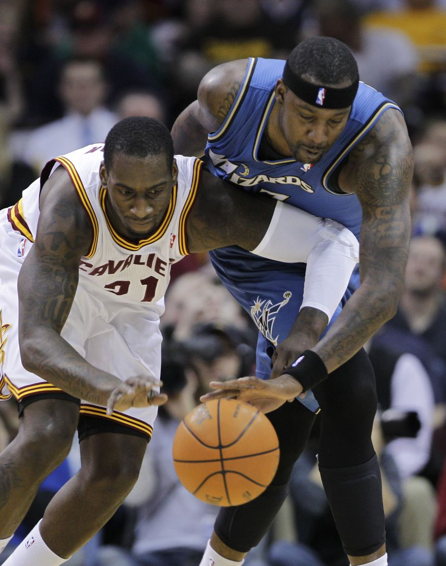 Washington Wizards' Andray Blatche, right, fights for a loose ball with Cleveland Cavaliers' J.J. Hickson in the first quarter of an NBA basketball game on Wednesday, April 13, 2011, in Cleveland. (AP Photo/Mark Duncan)