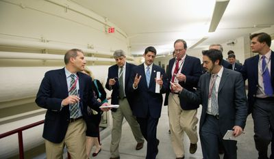 ROD LAMKEY JR./THE WASHINGTON TIMES Rep. Paul Ryan, Wisconsin Republican and Budget Committee chairman, talks with reporters after joining members of the party leadership in their response to President Obama's 2012 budget-plan speech on Wednesday.