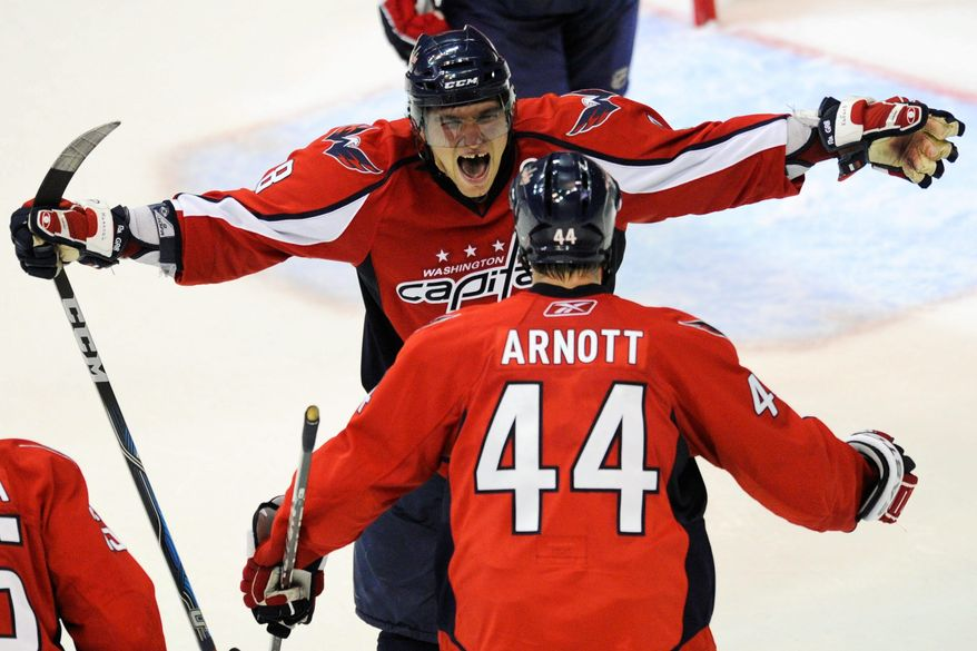 The Capitals' Alex Ovechkin celebrates with center Jason Arnott, who assisted on Alexander Semin's overtime goal that sealed Washington's 2-1 win over the New York Rangers on Wednesday. Washington leads the Eastern Conference quarterfinal series 1-0. (Drew Angerer/The Washington Times)