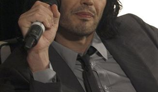 """Russell Brand speaks at a press conference in Sydney, Australia, Thursday, April 14, 2011 ahead of the premier of his new film """"Authur."""" (AP Photo/Rob Griffith)"""
