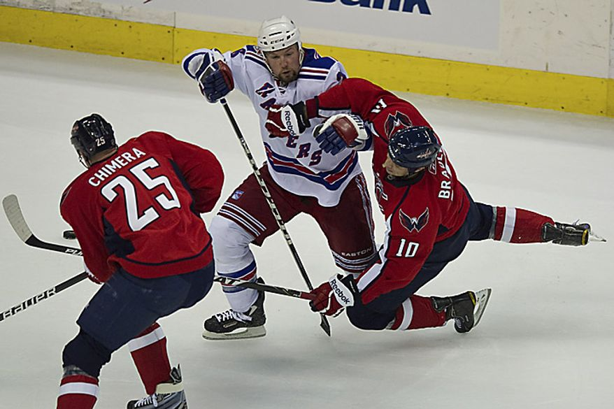 Bryan McCabe of the New York Rangers and Matt Bradley of the Washington Capitals tussle during a playoff game at the Verizon Center in Washington on Wednesday, April 13, 2011. (Drew Angerer/The Washington Times)