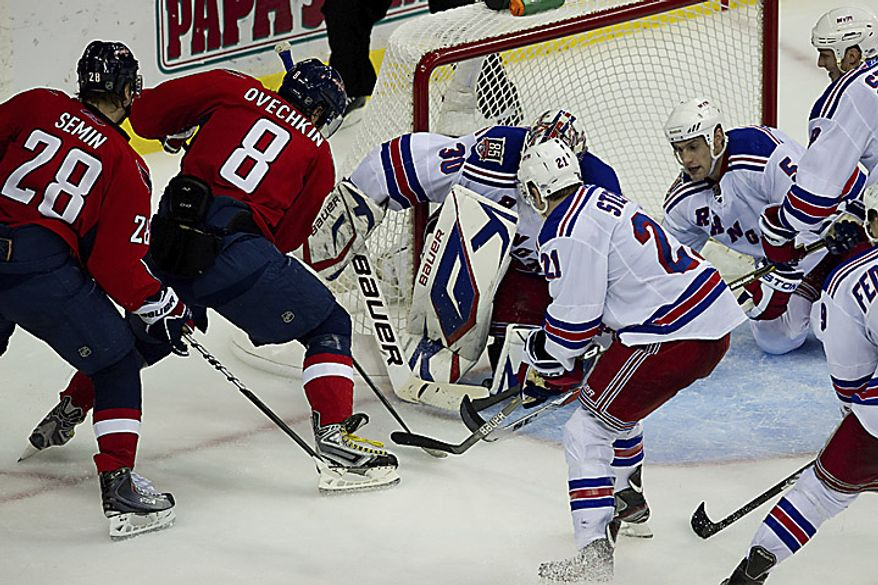 Washington Capitals forward Alex Ovechkin scores a goal to tie the game at 1-1 during the third period of a playoff game against the New York Rangers at the Verizon Center in Washington on Wednesday, April 13, 2011. (Drew Angerer/The Washington Times)