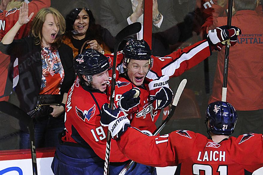 Capitals forward Alexander Semin celebrates with teammates after scoring the winning goal in overtime to give the Capitals a 2-1 win over the Rangers in a playoff game at the Verizon Center in Washington on Wednesday, April 13, 2011. (Drew Angerer/The Washington Times)