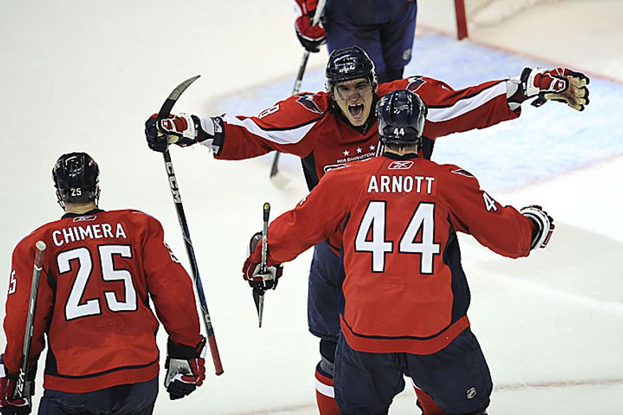 Capitals forward Alex Ovechkin reaches out to Jason Arnott for a hug after Alexander Semin scored the winning goal in overtime to give the Capitals a 2-1 win over the Rangers in a playoff game at the Verizon Center in Washington on Wednesday, April 13, 2011. (Drew Angerer/The Washington Times)