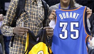 Tulsa Shock's Liz Cambage, right, of Australia, talks with Oklahoma City Thunder's Kevin Durant, left, in Oklahoma City, Wednesday, April 13, 2011. (AP Photo/Sue Ogrocki)
