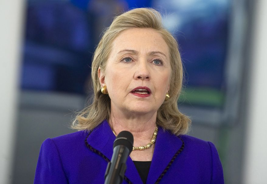 Secretary of State Hillary Rodham Clinton speaks to the media before meeting with German Chancellor Angela Merkel at the Chancellery in Berlin on Thursday, April 14, 2011. Mrs. Clinton is in Berlin to attend a two-day  meeting of NATO foreign ministers. (AP Photo/Saul Loeb, Pool)