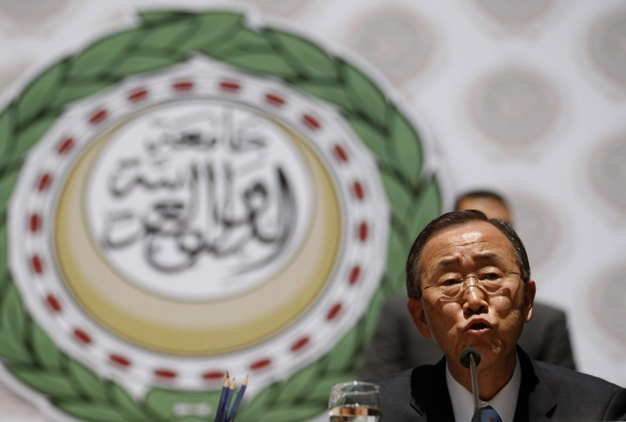 U.N. Secretary-General Ban Ki-moon speaks during a press conference after a meeting of international organizations concerning the Libya situation at the Arab League headquarters in Cairo on Thursday, April 14, 2011. (AP Photo/Khalil Hamra)