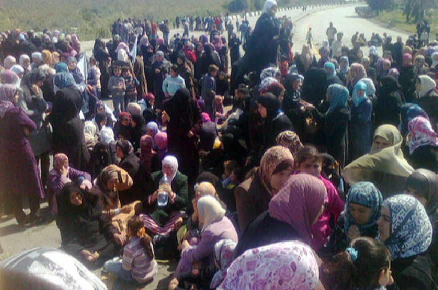 In an image taken on a cellphone camera by a citizen journalist and acquired by the Associated Press, Syrian women hold an anti-government demonstration in Banias, Syria, on Wednesday, April 13, 2011. (AP Photo)