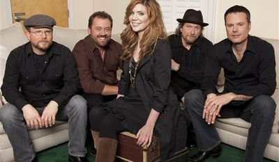 This March 29, 2011 photo, musician Alison Krauss, center, poses with Union Station, from left, Ron Block, Dan Tyminski, Krauss, Jerry Douglas, and Barry Bales in Nashville, Tenn. (AP Photo/Ed Rode)