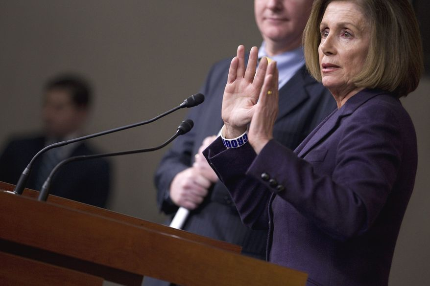 House Minority Leader Nancy Pelosi, California Democrat, accompanied by Rep. Chris Van Hollen, Maryland Democrat, who is his party's ranking member on the House Budget Committee, gestures during a news conference on Capitol Hill in Washington on Thursday, April 14, 2011. (AP Photo/Evan Vucci)