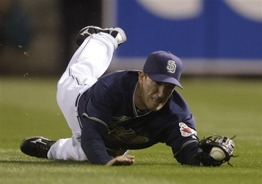 San Diego Padres right fielder Chris Denorfia makes a diving catch to rob Cincinnati Reds' Paul Janish of a hit in the ninth inning of a baseball game Monday, April, 11, 2011 in San Diego. (AP Photo/Lenny Ignelzi)