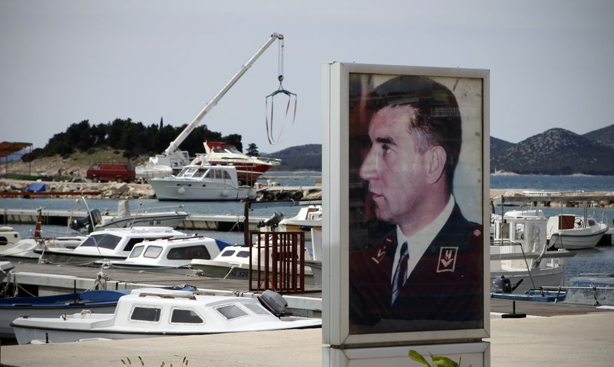 A poster depicting Gen. Ante Gotovina is seen in harbor in his hometown of Pakostane, southern Croatia, Thursday, April 14, 2011. (AP Photo/Darko Bandic)