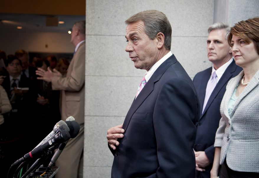 House Speaker John Boehner of Ohio, left, gestures during a news conference on Capitol Hill in Washington, Friday, April 15, 2011. From left are, Boehner, House Majority Whip Kevin McCarthy of Calif., and Rep. Cathy McMorris Rodgers, R-Wash. (AP Photo/Evan Vucci)