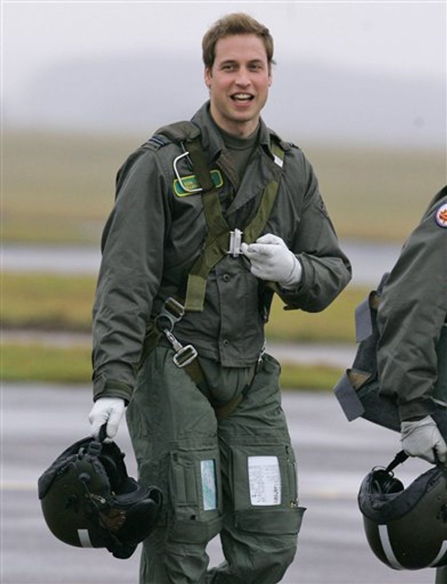 FILE - In this  Thursday, Jan. 17, 2008, file photo  Britain's Prince William gestures as he walks across the airfield at RAF Cranwell, Lincolnshire, England. Britain's monarchy has an enduring connection to the armed forces Prince William is part of the fourth successive generation to have served as a pilot. His grandmother, Queen Elizabeth II, is the military's ceremonial chief and joined the Women's Auxiliary Territorial Service during World War II, reaching the rank of junior commander and training as a driver.  (AP Photo/Kirsty Wigglesworth/file)