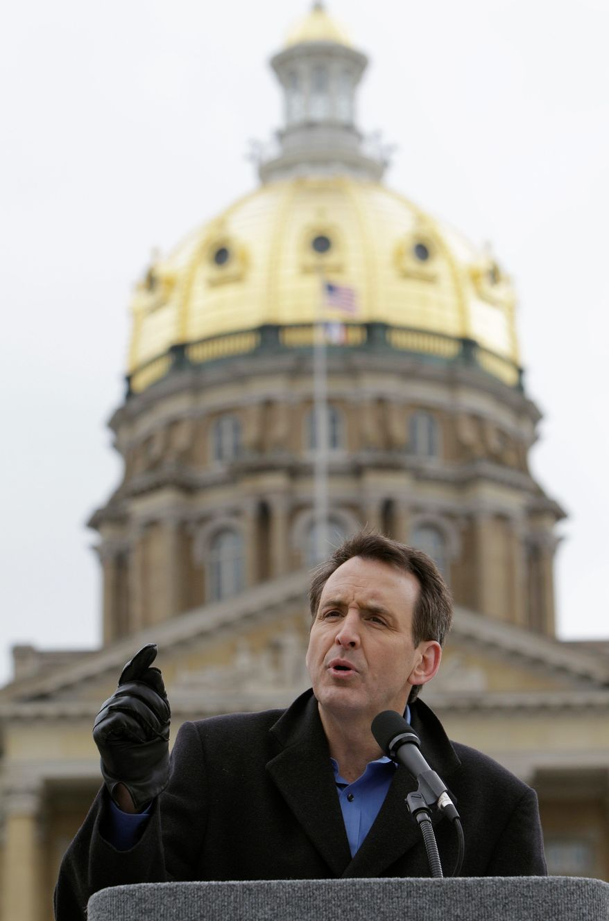 """Associated Press Former Minnesota Gov. Tim Pawlenty speaks at a tea party rally Saturday at the Statehouse in Des Moines, Iowa. """"I think one of our basic messages is, the government's too damn big,"""" the Republican presidential hopeful said."""