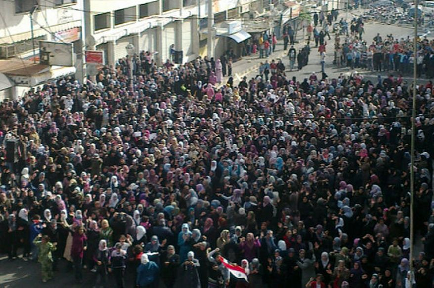 Syrian women attend an anti-government protest in Banias, Syria, on Saturday, April 16, 2011, in this photo taken by a citizen journalist on a cellphone and acquired by the Associated Press. (AP Photo)