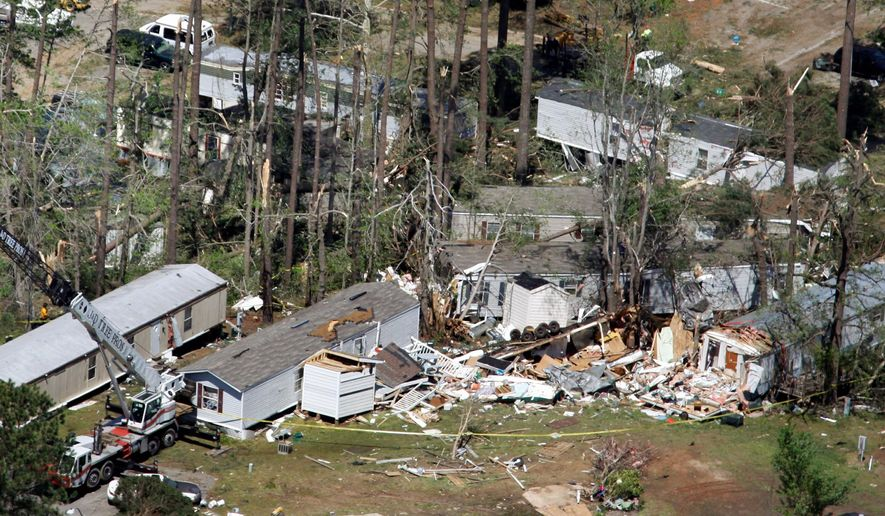 An aerial photo shows destroyed mobile homes in the Stony Brook Mobile Home Park in Raleigh, N.C., on Sunday. A tornado ripped through the area Saturday as a line of severe storms moved across the state. (Associated Press)