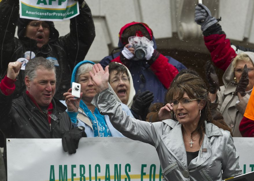 Former Alaska Gov. Sarah Palin waves to supporters after speaking at a tea party tax-day rally on Saturday, April 16, 2011, at the Capitol in Madison, Wis. (AP Photo/Morry Gash)