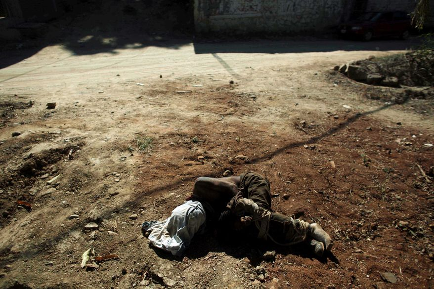 A victim of a narco-crime is found along a road on the outskirts of Acapulco, Mexico. There are a half-dozen words for drug cartel informants and double that for drug war dead, but Mexicans worry that developing a kind of offhand jargon anesthetizes people by making violence seem routine. (Associated Press)