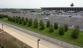 An above-ground Metrorail station at Washington Dulles International Airport would be located here, outside Daily Garage 1, at the airport in Chantilly, Va. (Barbara L. Salisbury/The Washington Times)