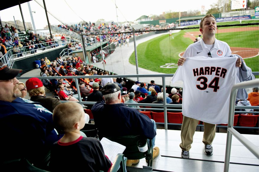 DREW ANGERER/THE WASHINGTON TIMES Bryce Harper T-shirt jerseys, such as this one hawked by Jeff Lamparski, were available in the stands during the Class A Hagerstown Suns' home opener Friday. Authentic Harper jerseys are selling for $200.