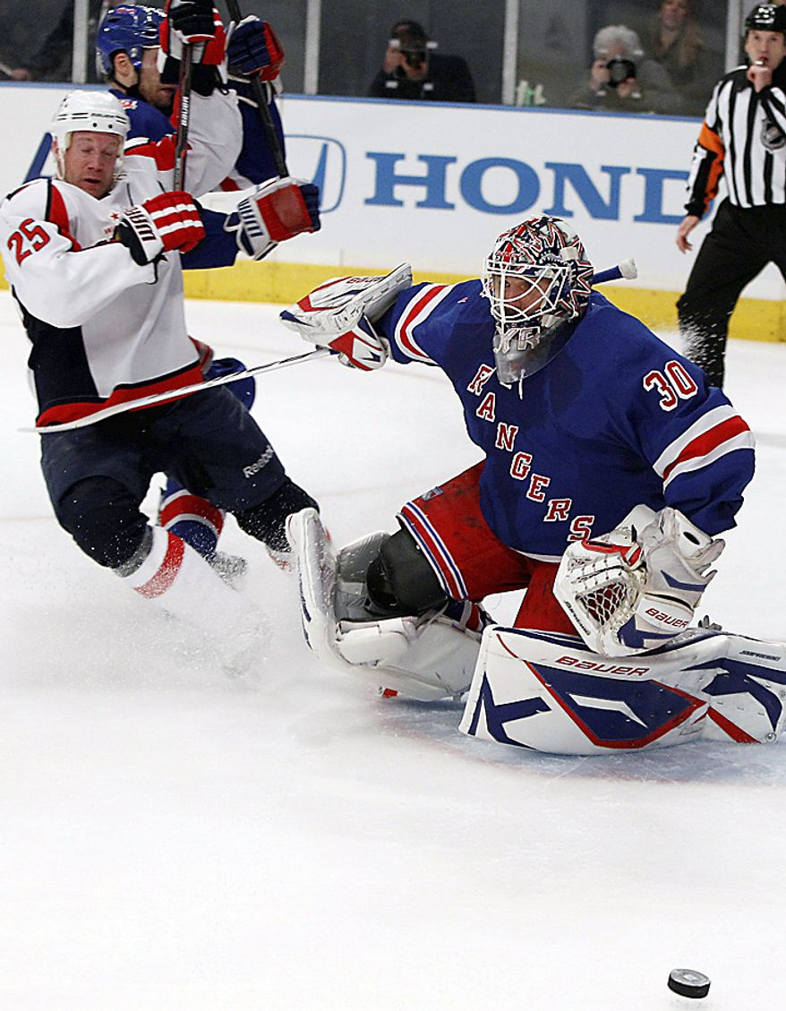 New York Rangers goalie Henrik Lundqvist (30) fends off Washington Capitals left wing Jason Chimera (25) in the first period of Game 3 during their first-round NHL Stanley Cup playoff series at Madison Square Garden in New York, Sunday, April 17, 2011. The Rangers won 3-2. (AP Photo/Kathy Willens)