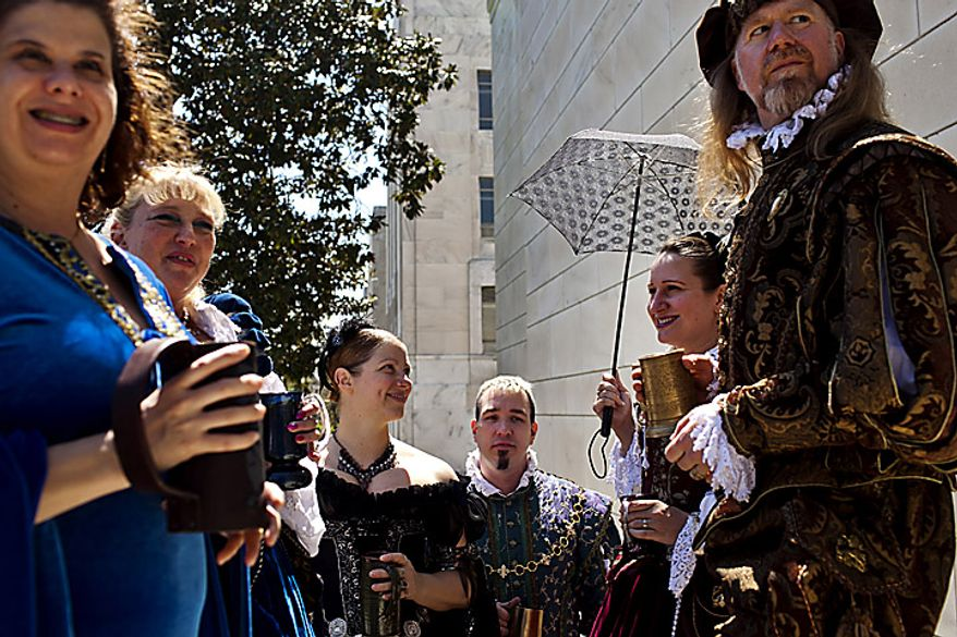 """Members of the group """"The Party That Never Ends"""" came to the open house open house for Shakespeare's Birthday dressed in Renaissance era clothing at the Folger Shakespeare Library, in Washington, D.C., Sunday, April 17, 2011. The group dresses up and travels around to various festivals around the country. (Drew Angerer/The Washington Times)"""