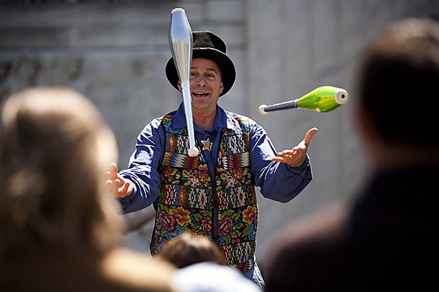 Renaissance era jester and entertainer Nick Newlin juggles for the crowd during an open house for Shakespeare's Birthday at the Folger Shakespeare Library, in Washington, D.C., Sunday, April 17, 2011. (Drew Angerer/The Washington Times)