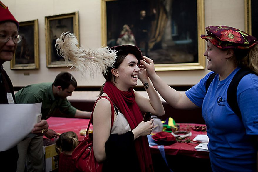 Rachel Carleton (left) tries on a Renaissance era hat as her friend Lyndsie Collis looks on during an open house for Shakespeare's Birthday at the Folger Shakespeare Library, in Washington, D.C., Sunday, April 17, 2011. The girls attend Cornell University and were in town for an environmental conference and decided to stop by the open house in the spare time. (Drew Angerer/The Washington Times)