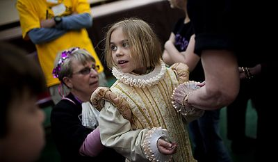 Anais Buron, 7 of Bethesda, tries on a Renaissance era dress during an open house for Shakespeare's Birthday at the Folger Shakespeare Library, in Washington, D.C., Sunday, April 17, 2011. (Drew Angerer/The Washington Times)