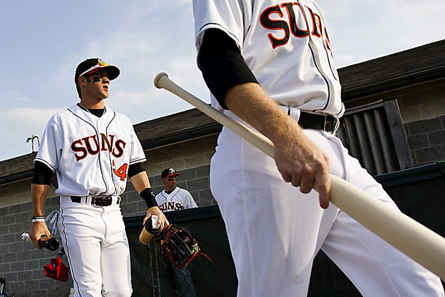 Bryce Harper emerges from the clubhouse for warm-ups before the Hagerstown Suns' home opener against the Lakewood Blueclaws at Municipal Stadium in Hagerstown, Md., on Friday, April 15, 2011. (Drew Angerer/The Washington Times)