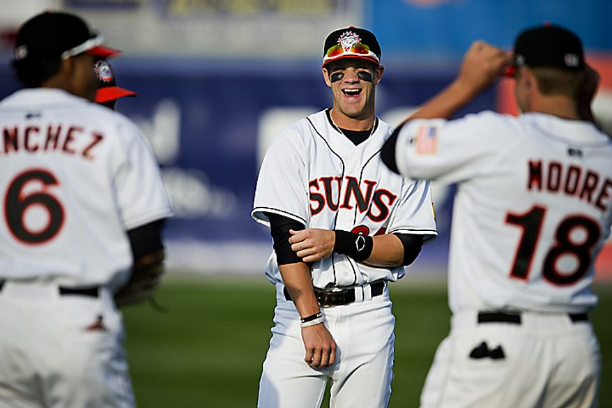 Bryce Harper jokes around with teammates during warm-ups before the Hagerstown Suns' home opener against the Lakewood Blueclaws at Municipal Stadium in Hagerstown, Md. on Friday, April 15, 2011. (Drew Angerer/The Washington Times)