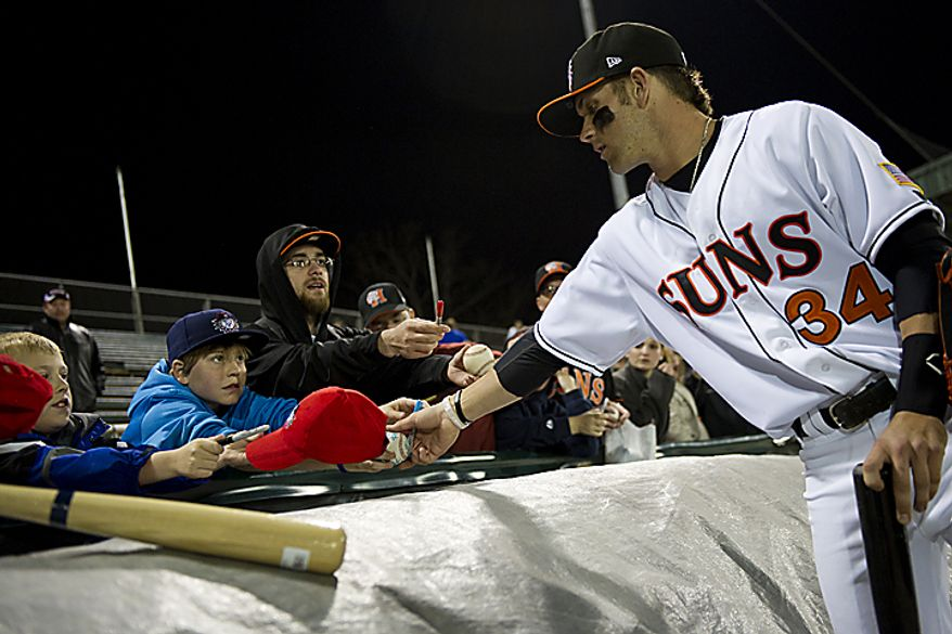 Bryce Harper stops to sign a few autographs for fans after the Hagerstown Suns' home opener against the Lakewood Blueclaws at Municipal Stadium in Hagerstown, Md., on Friday, April 15, 2011. (Drew Angerer/The Washington Times)
