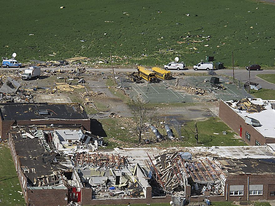 This aerial photo taken Sunday, April 17, 2011, shows damage to Page Middle School by a tornado that ripped through Gloucester, Va., on Saturday. Tornadoes and flash flooding left several people dead in Virginia, and crews are continuing to assess damage that severe weekend storms caused across several areas of the state. (AP Photo/The Virginian-Pilot, Randall Greenwell)
