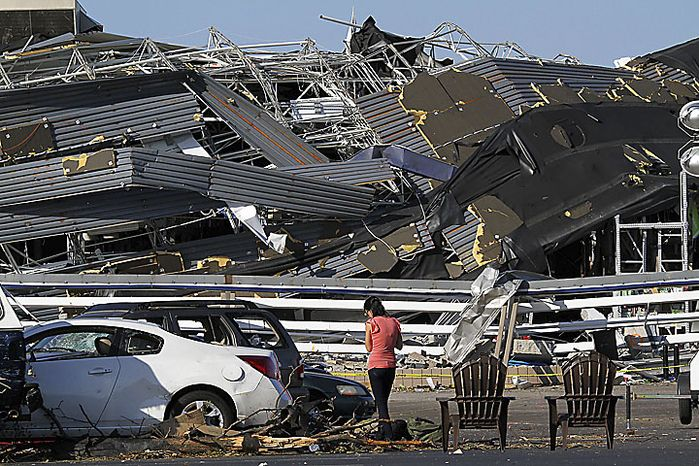 Annina Purdy, who was inside the Lowe's hardware store in Sanford, N.C., on Saturday, April 16, 2011, when a tornado destroyed the building, returned to the store's parking lot Sunday to reclaim personal belongings from her car. (AP Photo/Ted Richardson)