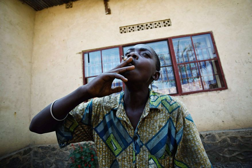 A Mai-Mai child soldier, recently demobilized by the United Nations, says he has nothing to do now and is considering a return to fighting. It is a decision many may make if not offered an alternative. (Lindsay Branham/Special to The Washington Times)