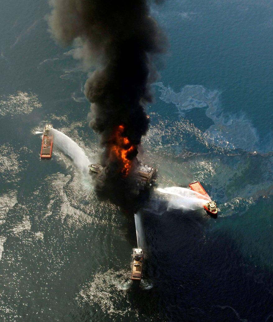 The Deepwater Horizon oil rig burns after the April 20, 2010, explosion in the Gulf of Mexico that killed 11 men. (Associated Press)
