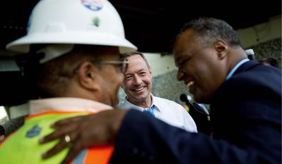 Mr. O'Malley looks on as PG County Executive Rushern L. Baker laughs it up with ICC construction worker Dave Jackson. (Drew Angerer/The Washington Times)