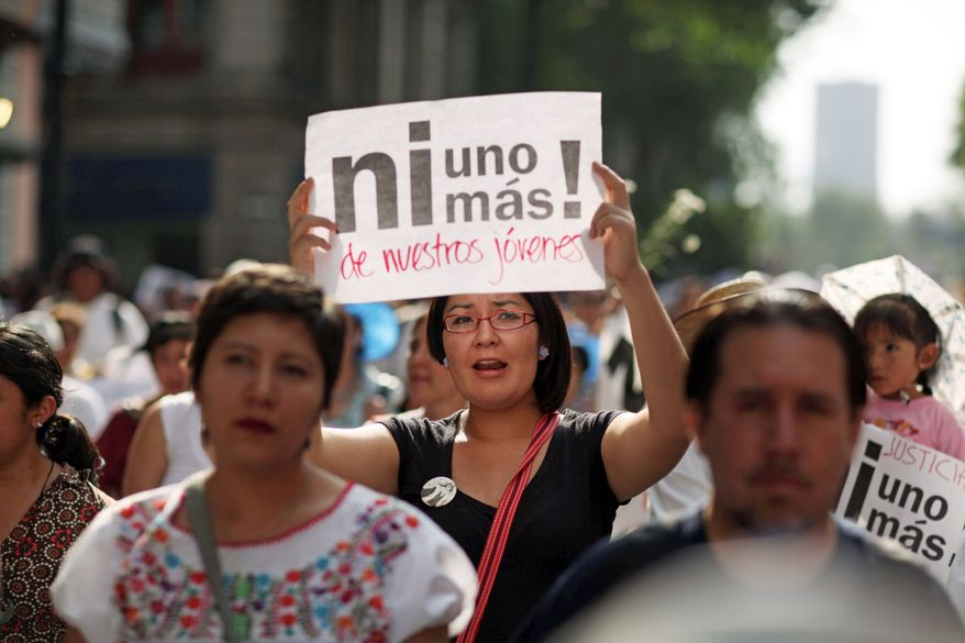 WAR-WEARY: The escalation of violence has led to protests like this one in Mexico City this month that drew thousands of participants. (Associated Press)