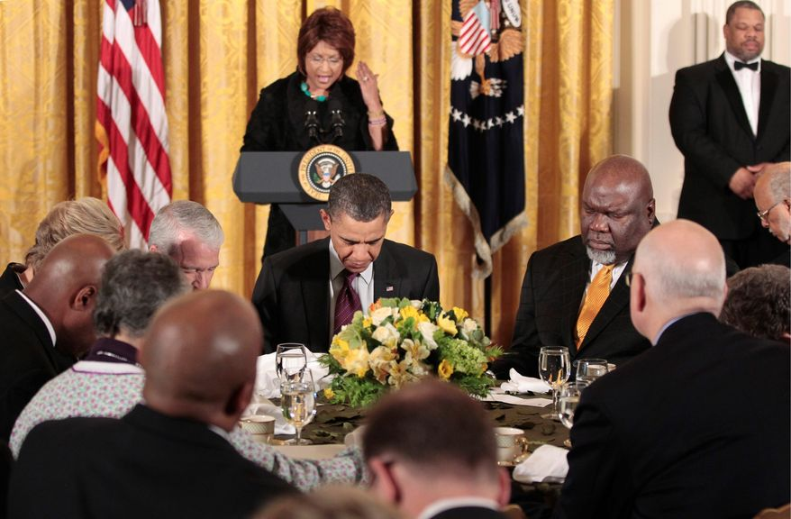 ASSOCIATED PRESS President Obama (center seated) and others lower their heads during an Easter prayer breakfast with Christian leaders in the East Room of the White House. Leading the prayer at the lectern is Vashti Murphy McKenzie, bishop at African Methodist Episcopal Church.