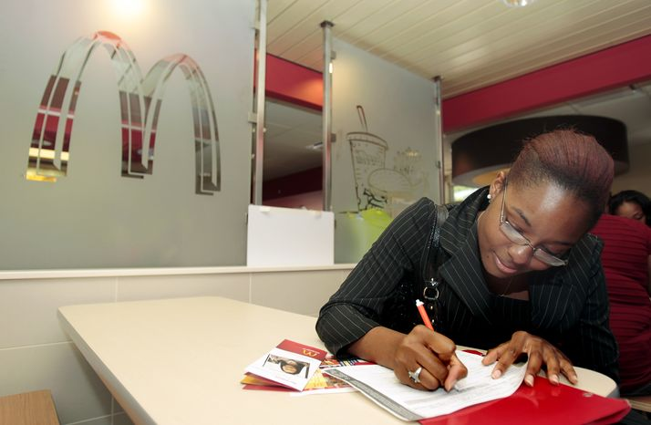 Spelman College student Alicia Scott, 23, of Riverdale, Ga., fills out a job application at an Atlanta McDonald's restaurant Tuesday, April 19, 2011. McDonald's hopes to hire 50,000 new workers nationwide on its National Hiring Day. (AP Photo/John Bazemore)
