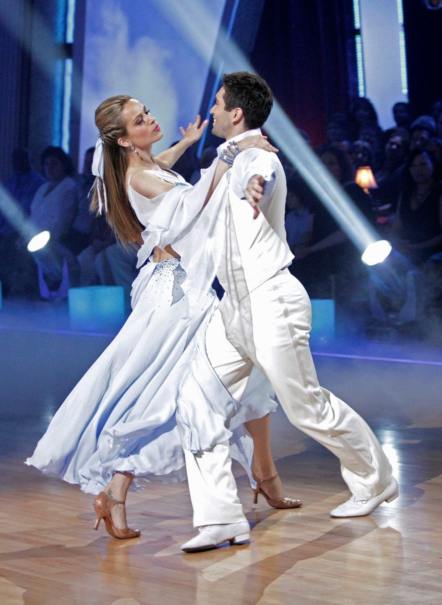 """Model Petra Nemcova and her partner, Dmitry Chaplin, were eliminated from ABC's """"Dancing With the Stars"""" on Tuesday. The show inspired Miss Nemcova to start holding dance-a-thons as fundraisers for her charity, the Happy Hearts Fund. (Associated Press)"""